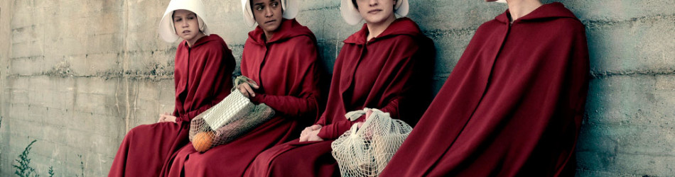4 woman sitting on bench handmaids tale