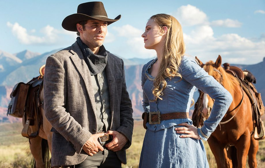 man in cowboy hat and woman in old west period clothing