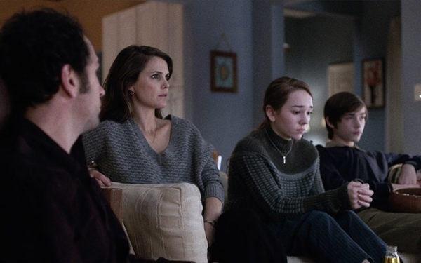 family looking forlorn on couch