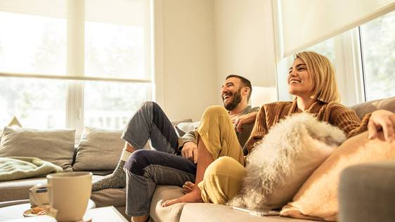 couple laughing watching tv
