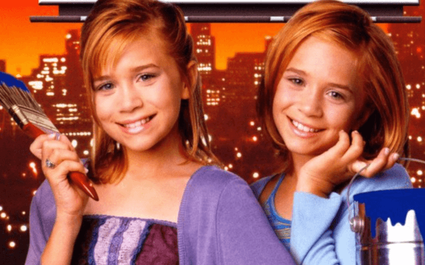the olsen twins holding paint