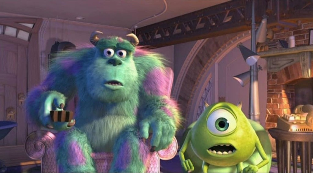 mike and sully from monsters in sitting in chairs