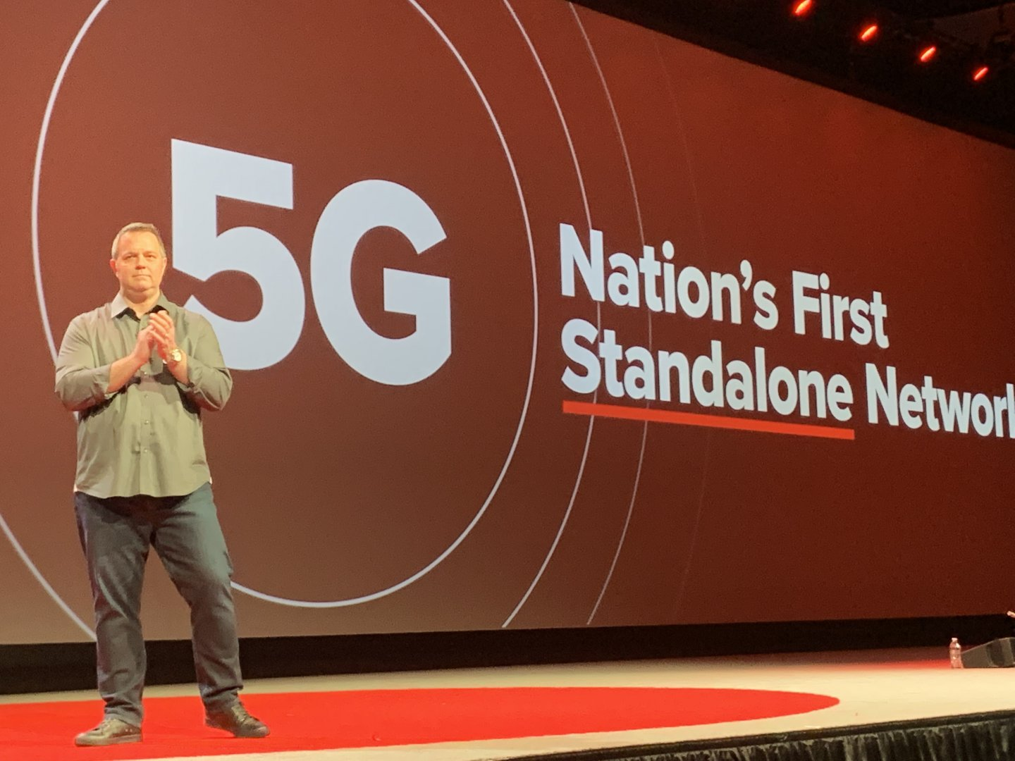 man on stage talking about 5g