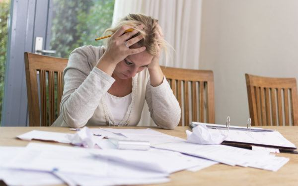 Stressed woman looking at papers