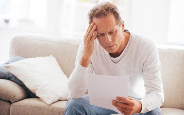 Man stressed over piece of paper