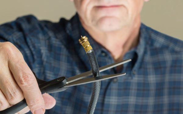 man cutting cable cord