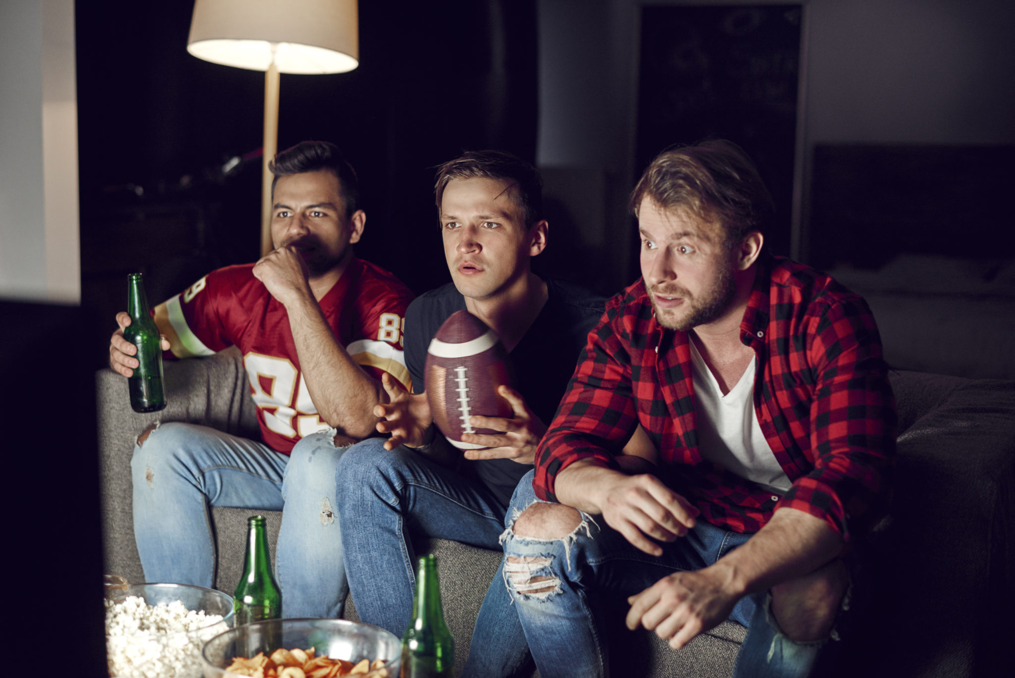 Football fans watching intensely