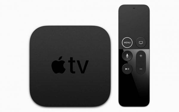 An overhead view of an Apple TV 4K and its remote control